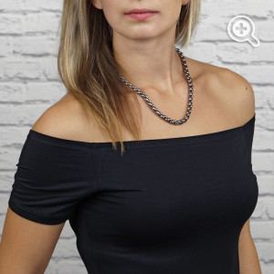 woman wearing titanium chain