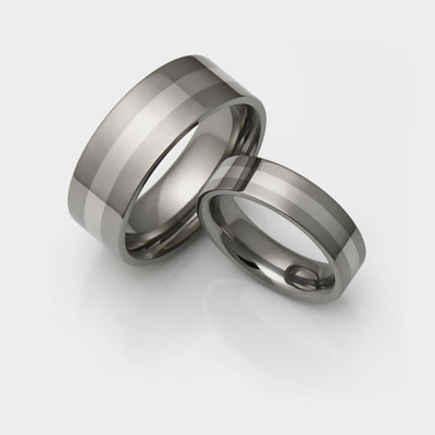 Titanium wedding ring set with thin inlays.
