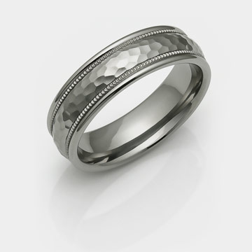 hammered titanium ring with domed center, milgrain channels and rounded sides