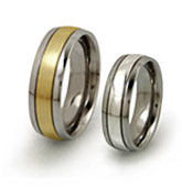 titanium rings with precious metal center and thin grooves
