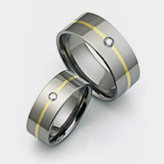 Titanium wedding bands with gold and diamond inlays